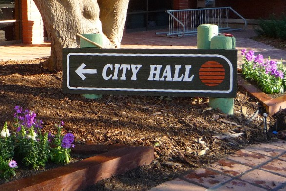 City Hall sign in small garden